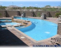 Pool 4 - After - Angle 1 - Pool with reverse negative edge, sitting area, wading pool, step stones to pool