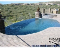 Pools - Negative Edge Pool with Spa with Brick Paver Decking