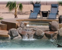 Features - Raised Spa With Rock spillway
